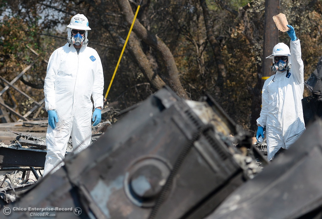 . NRC employees along with Department of Toxic Substances Control representatives search the ashes of a home burned during the Wall Fire off of Old Olive Hwy. for toxic substances and hazardous waste Wed. Aug. 2, 2017. (Bill Husa -- Enterprise-Record)