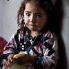 Five year old Setayish sits in a relative's home near Almar's district center. Her family had to flee their village some kilometers away from the bazaar after fighting broke out a week ago. Photo: NRC/Jim Huylebroek