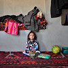 Five-year-old Setayish sits in a relative's home near Almar's district center. Her family had to flee their village some kilometers away from the bazaar after fighting broke out a week ago. Photo: NRC/Enayatullah Azad