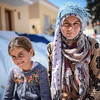 Fatima has fled from Deir ez-Zor in Syria together with her family. They are now at Chios in Greece. Photo: Tiril Skarstein, NRC<br /> <br /> Quotes from Fatima:<br /> -We were attacked from all sides, both the armed groups and the government.<br /> -We left from Syria for a better life, but here it is very difficult. It is very stressful. <br /> -The police cannot guarantee the security in Vial. We did not feel safe there.<br /> -We left from Syria to find peace, and then we were placed in a closed detention facility. <br /> -Europe need to open their borders. We have nothing here. <br /> -It is a very bad situation here. <br /> -We are Syrians, we only want to be able to continue our lives. <br /> -There is nothing here. Look around you. <br /> -I have been here 20 days and we do not know for how long we need to continue to say here. <br /> -We want to go to Germany. <br /> -Europe need to open their borders. We are in danger back in Syria. Please open the borders. Please let us continue our lives.