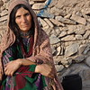 HazarGul (50) and her family have fled from Badghis to Herat. Now they are living in Shaidaee Settlement. Photo: NRC/Enayatullah Azad <br /> <br /> Quote:<br /> <br /> At this moment, we are hungry and thirsty. What else we can ask for apart from food. My children are small and my husband is paralyzed. I am going out in the city and begging for people to feed my children.