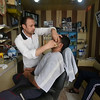 """Lazaeen (40), the barber and hairdresser<br /> """"I joined a training course to become a barber in Syria. After a few years I had my own shop"""", says Lazeen who is the father of three children. <br /> <br /> """"My biggest wish is to come back to Syria"""", says Lazaeen. <br /> <br /> His customer, Qamishli, is a regular customer. """"Lazaeen is the best barber in the camp, I always come here to get my haircut and beard done"""", he says. """"Life in the camp is not good. I wish a better future and life for my children"""", he says.<br /> Qamishli has several tattoos on his arms. """"I got it in Syria, many years ago before I got married. I did it for someone I was in love with"""", he smiles.<br /> Photo: Hanne Eide Andersen/Flyktninghjelpen"""