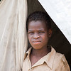 10 year-old Buk fled his hometown in South Sudan when it was attacked. He has lost both of his parents. Now he lives in a tent provided by the NRC in Liechton camp in Gambella together with his aunt and another family of six. <br /> <br /> BUK (lost both parents)<br /> Buk is a refugee from South Sudan and now settled in Lietchor Camp in Gambella, due to recent war between the South Sudanese government forces and the former Vice president allied. The ten year-old boy was found by a relative between Nasir County and Jikmir village. When the fighting spread to Upper Nile State, his father was shot dead in Nasir town and he ran away with his mother. On their way, his mother was killed in front of him. Another woman took him with her and her children. Buk is the only child from his mother and father, and accidently both of them died on the same day.<br /> Buk was in shock and afraid when he was fleeing from the war with an unknown woman. They walked long distances and reach Wanthoa district in Ethiopia. Here they found Buk's aunt and he was submitted to her. He spent three weeks with his aunt in that district and the he was not happy. When he played with his cousins he felt dizzy and shocked and he cried a lot. He did not talk the first weeks when he arrived in the refugee camp. His aunt, Nyeboul Rik, also felt bad. She kept thinking about the death of Buk's mother, Nyibol Deng, at all times.<br /> When Buk's parents were alive he had everything he needed. He went to school, played games and had many friends. Now, he is only thinking of what happened to his parents and he misses them a lot.<br /> The three-month long civil war has caused many orphans and refugees. On every border in South Sudan, there are many refugee camps which emerged recently. Buk lives in a shelter (given by NRC) with his aunt, another woman and 5 kids, a total of 8 people in a small tent.<br /> <br /> <br /> Photo Credit: NRC/Ingrid Prestetun