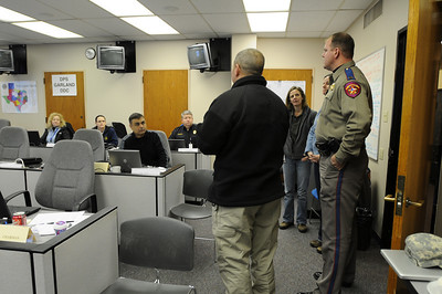 In this image released by the Texas Military Forces, Col. William Hall, Joint Task Force 71 commander visits the Disaster District Committee center in Garland, Texas, Saturday, Feb. 5, 2011. Each committee is composed of local representatives of the state agencies, boards, and commissions and organized volunteer groups with representation on the emergency management council to ensure that state and federal emergency assets are made available asneeded to provide the most efficient and effective response possible. (Photo/100th Mobile Public Affairs Detachment, Army National Guard Sgt. Melissa Bright)
