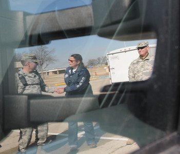 In this image released by the Texas Military Forces, Brig. Gen. John F. Nichols, Adjutant General for the state of Texas, Col. William Hall, Joint Task Force 71 commander and Alice Rogers with Texas Department of State Health Services, inspect emergency response equipment trailers in Fort Worth, Texas, Sunday, Feb. 6, 2011. The trailers belong to units with Texas' CBRNE (chemical, biological, radiological, nuclear and explosives) Task Force, headquartered in Austin, Texas and deployed to North Texas for a two-week Super Bowl 45 mission supporting civil authorities in the area. Sustaining key equipment in a state of constant readiness is just one of many elements of the task force's ability to provide immediate response when called upon by civilian authorities. (Photo/100th Mobile Public Affairs Detachment, Army National Guard Sgt. Melissa Bright)