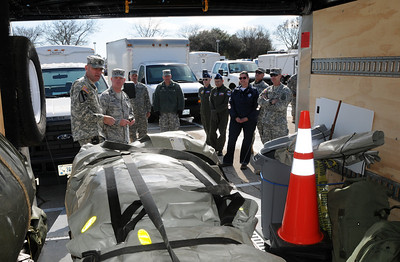 In this image released by the Texas Military Forces, Texas' Adjutant General, Brig. Gen. John F. Nichols, Col. William Hall, Joint Task Force 71 commander and Alice Rogers with Texas Department of State Health Services inspect emergency response equipment trailers in Fort Worth, Texas, Sunday, Feb. 6, 2011. The trailers belong to units with Texas CBRNE (chemical, biological, radiological, nuclear and explosives) Task Force, headquartered in Austin, Texas. The men and women deployed to North Texas as part of a joint training exercise headed by Joint Task Force 71, for a two-week Super Bowl 45 operation supporting civil authorities in the area. Sustaining key equipment in a state of constant readiness is just one of many elements of the task force's ability to provide immediate response when called upon by civilian authorities. (Photo/100th Mobile Public Affairs Detachment, Army National Guard Sgt. Melissa Bright)