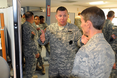 "n this image released by Texas Military Forces, leaders of Joint Task Force 71 receive a presentation given by a representative of the Department of Energy at Bee Caves in Austin, Texas on Friday, 15 March 2011. The presentation covered the roles and responsibilities of the DoE, highlighting their capabilities and duties in a disaster. The JTF remains ever vigilant in keeping informed through interagency interaction, continually embodying their motto ""Always Ready, Always There."" (Photo/100th Mobile Public Affairs Detachment, Army National Guard 1st Sgt Tad Browning)"