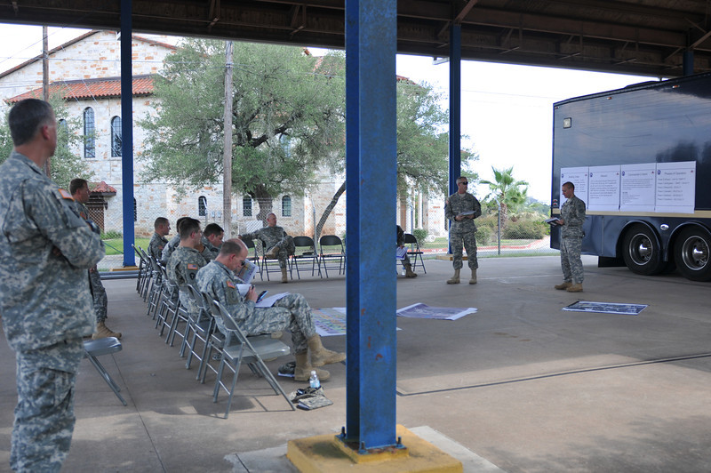 In this image released by the Texas Military Forces, Joint Task Force-71 leaders go over their 2011 Annual Training plan at Bee Caves Armory, Austin, Texas, Wednesday, July 6, 2011. With close to 500 individuals participating in this event, planning will be the key to success.  (Photo/Joint Task Force 71, Army National Guard Staff Sgt. Melissa Bright)