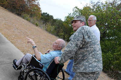 In this image released by the Texas Military Forces, Army Lt. Col. Thomas Lewis escorts former Chief Warrant Officer Caesar Salas during a return visit the Bee Cave Armory just west of Austin, Texas, Thursday, August 25, 2011. Salas was stationed at the armory from 1960 to 1964, when the Army's main mission in the area was to protect Bergstrom Air Base from potential attack from the Russians. Joint Task Force 71 now occupies the armory; which is the command and communications headquarters for the FEMA Region IV Homeland Response Force.  (Photo/Joint Task Force 71, Army National Guard Staff Sgt. Melissa Bright)