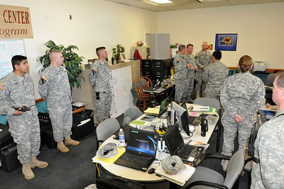 In this image released by the Texas Military Forces, TXMF leadership pauses during support operations to recognize individuals for their contributions in Fort Worth, Texas, Sunday, Feb. 6, 2011. The representatives are from geographically separate unites that include Arkansas' 61st Civil Support Team, Oklahoma's 63rd CST, and Texas' Chemical, Biological, Radiological, Nuclear and Explosives Task Force as well as members of Texas' Department of Public Safety. The men and women deployed to North Texas as part of a joint training exercise headed by Joint Task Force 71, headquartered out of Austin, Texas, for a two-week Super Bowl 45 support operation.  (Photo/100th Mobile Public Affairs Detachment, Army National Guard Sgt. Melissa Bright)