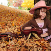 Olivia leans on her saddle in this cool fall day.