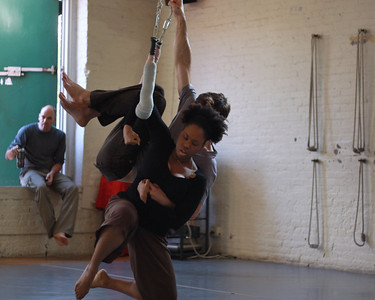 Bria and John doing things on the trapeze.