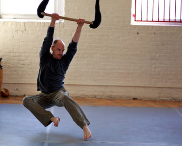Steve exercises his kung fu grip on the low flying trapeze.