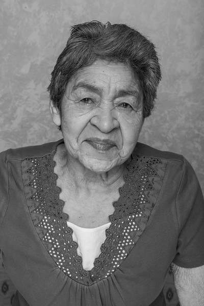 She was reluctant to get her picture taken, but after a whole family begging, she finally stepped in front of the camera. My Grandma Martinez.