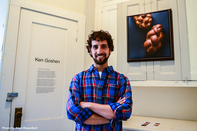"""Artist and Painter Ken Goshen poses in front of his art exhibit """"Encounters of Bread"""" at Governer's Island."""