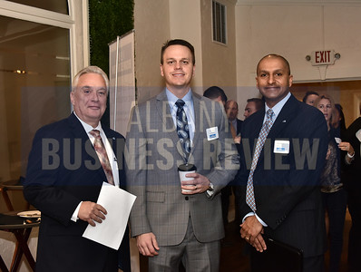 Dr. Kirk Panneton, left, and Telly Jones of BlueShield NENY with Todd Edwards of Arthur Gallagher