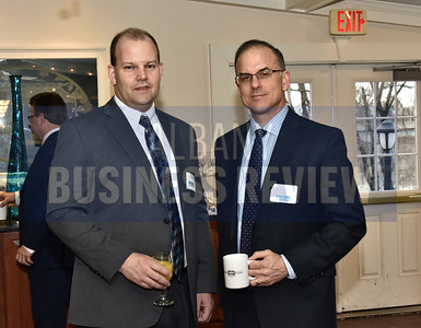 Richard Curry of CarePatrol of the Capital District and Michael Cowles of Janney Montgomery Scott
