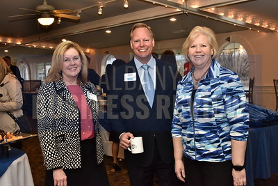 Pam Allers of JFA, left, David Horan of JPMorgan Chase Bank and Kathleen Pingelski of MicroKnowledge