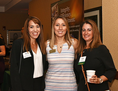 Sandy DenBesten from Brown & Brown of New York Inc., left, with Lauren Seward and Martha Mabeus from Austin & Co.