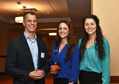 Matthew Ingold from Benetech, left, with Kaitlyn Herwig from AllyHealth Telemedicine and Emily Dessingue from Cresa Albany