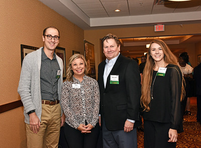 Ryan Cureau from RPR Studios, left, Kate Fruscione from CAP COM Federal Credit Unon, Russell Wilks and Chantalle Todd from RPR Studios