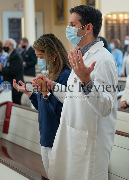 Dr. James Witney and his wife Stephanie Witney pray during the annual White Mass honoring health care professionals at the Basilica of the National Shrine of the Assumption of the Blessed Virgin Mary in Baltimore Oct. 18. (Kevin J. Parks/CR Staff)