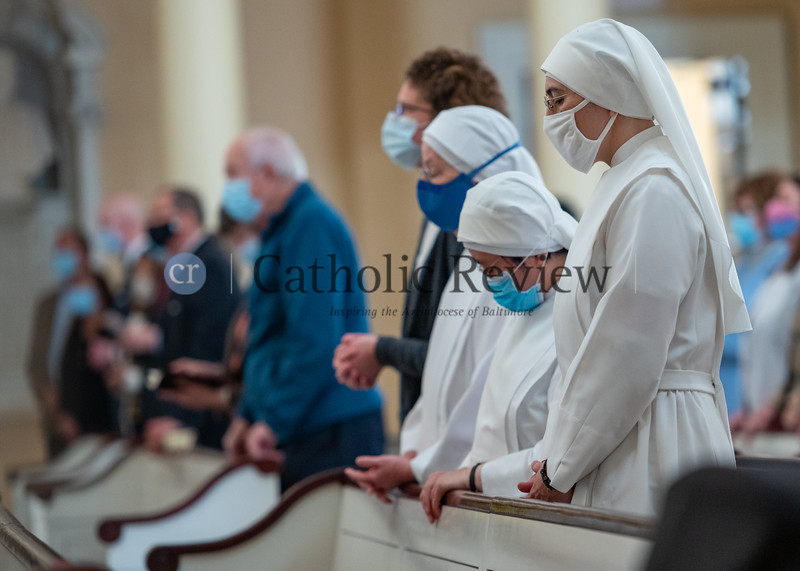 Members of the Little Sisters of the Poor, sponsors of St. Martin's Home for the Aged in Catonsville, attend the White Mass, a special liturgy honoring health care professionals Oct. 18 at the Basilica of the National Shrine of the Assumption of the Blessed Virgin Mary in Baltimore. (Kevin J. Parks/CR Staff)