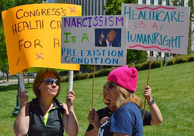 Opponents of President Trump and the Republican backed American Health Care Act demonstrate in Denver.