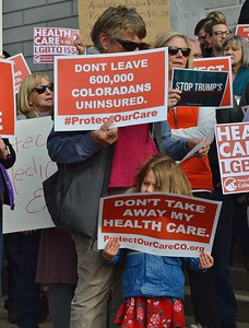 Opponents of health care cuts demonstrate at the State Capitol in Denver.