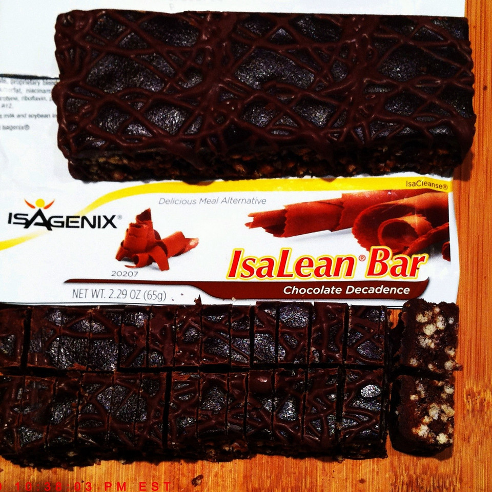"""All IsaLean Bars are terrific tasting. Each Bar constitutes a """"ISAGENIX Meal Replacement."""" One way to nibble on these Bars is to pre-cut it into a number of bite sized pieces and either pack them back into the wrapper or place in a sandwich size baggie. In the image above the resulting cuts created 26 bite-sized pieces, making for a scrumptious treat. And eating it this way, personally, after about 7 or 8 pieces, I'm done munching for several hours, consuming about 80 to 90 calories, of the 250 Calories for the entire Bar... A great, satisfying treat. There are 4 flavors/styles of IsaLean Bars available; its hard to pick a favorite, as they are all great."""