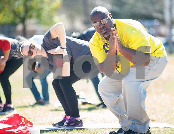 Terence Thompson of Tyler tries a yoga class for the first time during Fit City Day in the Park at Woldert Park in Tyler Feb. 27, 2016. The free public event aimed to educate the community about low-cost health, fitness and wellness opportunities available in the Tyler area. Fit City Tyler is a community initiative to make Tyler a healthy community through events and campaigns that promote health.  (Sarah A. Miller/Tyler Morning Telegraph)