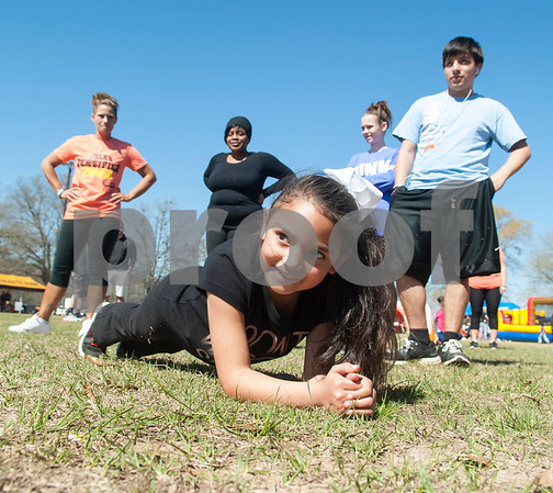 Brianna Garcia, 8, of Tyler, participates in the East Texas Plank Challenge during Fit City Day in the Park at Woldert Park in Tyler Feb. 27, 2016. The free public event aimed to educate the community about low-cost health, fitness and wellness opportunities available in the Tyler area. Fit City Tyler is a community initiative to make Tyler a healthy community through events and campaigns that promote health.  (Sarah A. Miller/Tyler Morning Telegraph)