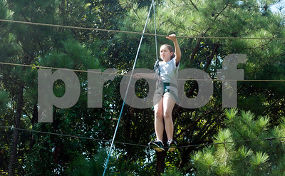 copyright 2012 Sarah A. Miller/Tyler Morning Telegraph  Rachel Berkley, 11, of Tyler, walks the ropes course at ETMC's Kids In Motion program Thursday at ETMC Behavioral Health Clinic in Tyler. The program teaches kids about nutrition and fitness during a week-long session of classes, outside play and structured exercise.