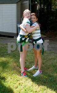 copyright 2012 Sarah A. Miller/Tyler Morning Telegraph  Isabela Gage, 10, of Tyler, right, hugs Savannah Sawyer, 10, of Tyler, after Sawyer completed the ropes course at ETMC's Kids In Motion program Thursday at ETMC Behavioral Health Clinic,in Tyler. The program teaches kids about nutrition and fitness during a week-long session of classes, outside play and structured exercise.