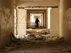 A man walks through a corredor of the looted Ibn Zuhur Hospital. While the total number of people living with HIV remains small in Iraq, many have reported numerous infringements of their civil liberties, including  having to sign a form agreeing only to marry others with the virus. Others say they were virtually imprisoned at the AIDS/HIV ward at the Ibn Zuhr Hospital. If  the pre-war situation of denial may not have been ideal, the postwar situation is worse, as most people registered with AIDS no longer go to the hospital, looted of all its equipment. This means that monitoring the disease has become practically impossible, as patients no longer receive their monthly checkups.(Australfoto/Douglas Engle)