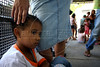 Gabriele Martins, 7, who has symptoms of dengue fever, waits for attention at the entrance of a public hospital in Rio de Janeiro, Brazil, April 2, 2008. A recent outbreak of dengue fever has swamped hospitals in the city, and the Brazilian Air Force (FAB) is operating 3 field hospitals to help contain the fever. At least 67 people have died this year from dengue which spread by mosquitoes. The disease is normal in Rio, but an apparent neglect of prevention measures has let is get out of control this year.  (Australfoto/Douglas Engle)