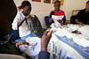Children participate in an embroidery workshop at the Nyumbani Children's Home in Nairobi, Kenya, Nov. 26, 2005. Founded in 1992, is an active response to the rising number of HIV infected children born in Africa every day. Because infants carry many of their mothers' antibodies through their first year of life, a number of newborns with infected mothers may give a 'false positive' and never actually develop the disease themselves. In fact, a full 75% of babies who test positive at birth will eventually be found not to have the virus. At Nyumbani, 'home' in Swahili, children are cared for until a definite assessment of their HIV status can be made. Children who are eventually found not to have the virus are adopted or find other homes. Children who are found to be HIV+ are given the best nutritional, medical, in particular, anti-retroviral therapy, psychological, academic, spiritual care available and live at Nyumbani until they become self-reliant. Approximately 100 children from newborn to twenty-three years live at the home.(Australfoto/Douglas Engle)