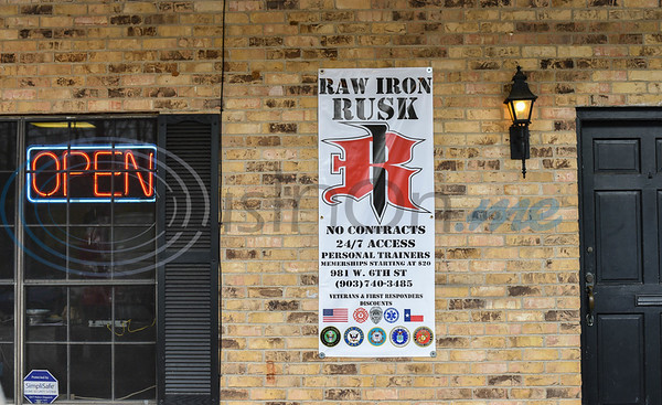 A sign hangs next to the front door of Raw Iron Gym in Rusk. The gym celebrated their Ribbon Cutting and Grand Opening on Saturday, January 18. As part of the special day the gym had group classes, special guests, trainers, a bench press competition, deadlift party, door prizes and a special $1 sign-up fee for the month of January. (Jessica T. Payne/Tyler Morning Telegraph)