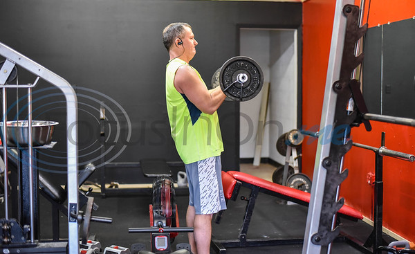 Jody Tylich of Rusk works out during the Grand Opening of Raw Iron Gym on January 18.  As part of the Grand Opening day celebration the gym had group classes, special guests, trainers, a bench press competition, deadlift party, door prizes and a special $1 sign-up fee for the month of January. (Jessica T. Payne/Tyler Morning Telegraph)