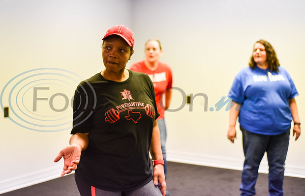 Sheila Bradley tries out a Zumba class at Raw Iron Gym in Rusk during their Grand Opening on Saturday, January 18. The gym also offers spinning and posing classes and plans to add more in the near future. (Jessica T. Payne/Tyler Morning Telegraph)