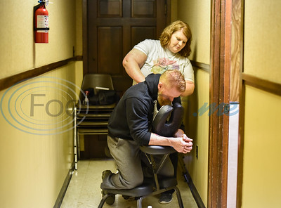 Licensed Massage Therapist Crystal Gafford gives a chair massage at Raw Iron Gym in Rusk as part of their Grand Opening celebration day on Saturday, January 18. (Jessica T. Payne/Tyler Morning Telegraph)