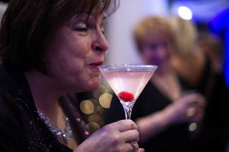 Mary Fortunato-Habib of Paxton drinks a Cosmo during Saturday's UMass Memorial - Health Alliance Hospital Gala at the Double Tree in Leominster.  Sentinel & Enterprise photo/Jeff Porter