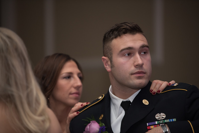 Community Leader Award winner and Firefighter for the City of Fitchburg, John Girouard, listens as he's introduced by HealthAlliance CEO during Saturdays Gala Hosted by UMass Memorial - HealthAlliance Hospital at the Double Tree in Leominster.  Sentinel & Enterprise photo/Jeff Porter