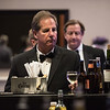 Henry Botticello buys a drink during cocktail hour of Saturdays Gala hosted by UMass Memorial - HealthAlliance Hospital at the Double Tree in Leominster.  Sentinel & Enterprise photo/Jeff Porter