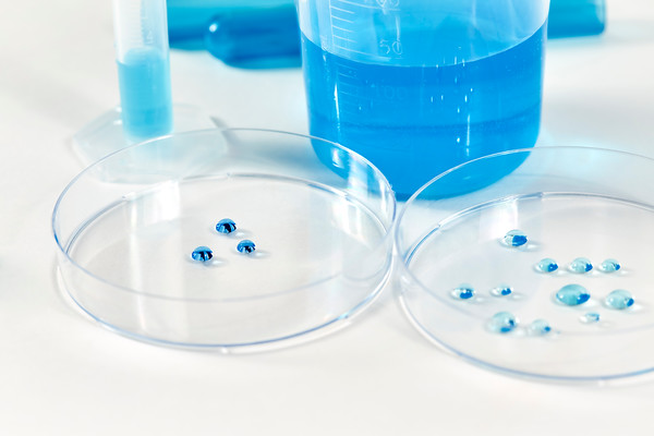 Blue Liquid Solution droplets in Petri Dish