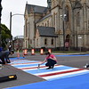 Volunteers help paint wider curbs and colorful crosswalks on North Clinton Avenue Sept. 29, 2019, during the Complete Streets Makeover. A complete street is a street that is safe and accessible for all users, including bicyclists and pedestrians.