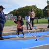 Six-year-old Nolani Maldonado-Arguinzoni and her mom, Adrian Arguinzoni, at left, and 7-year-old Quadiar Manual and his dad, Kevin Manual, at center help wider curbs on North Clinton Avenue Sept. 29 during the Complete Streets Makeover.