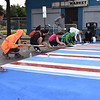 Volunteers help lay down reflective tape to line colorful crosswalks on North Clinton Avenue Sept. 29, 2019, during the Complete Streets Makeover. A complete street is a street that is safe and accessible for all users, including bicyclists and pedestrians.  (Photo: Common Ground Health)