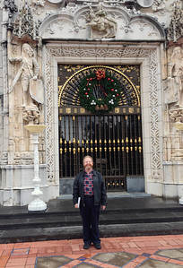 Geoff in front of the main door of the residence