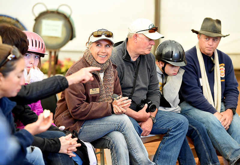 Tamara Merritt, center, associate executive director at Hearts & Horses Theraputic Riding Center, leads a discussion Tuesday, Oct. 10, 2017, with Changing Leads participants and volunteers at the ranch in Loveland. Students from five middle schools are spending Tuesdays at the ranch for eight weeks in the Changing Leads program, learning social and emotional skills while working with the horses. (Photo by Jenny Sparks/Loveland Reporter-Herald)